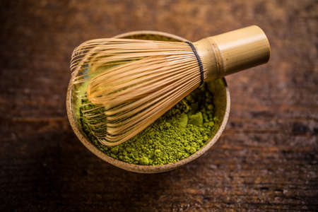 green drink powder: Matcha green tea in bowl with whisk Stock Photo