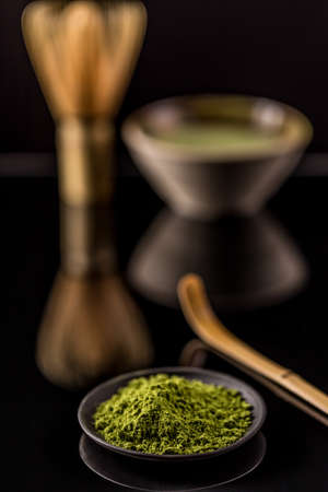 green drink powder: Powder green tea, matcha in black plate Stock Photo