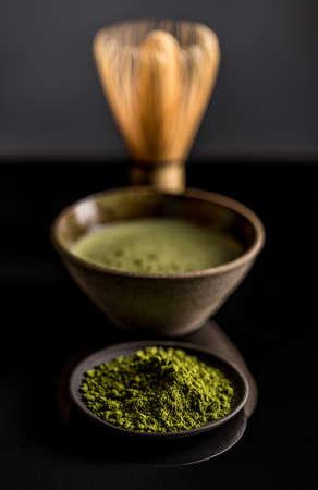 green background: Organic green matcha tea on black background