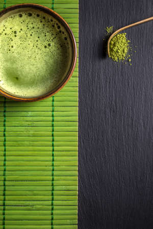 green drink powder: Matcha tea and spoon with space for text