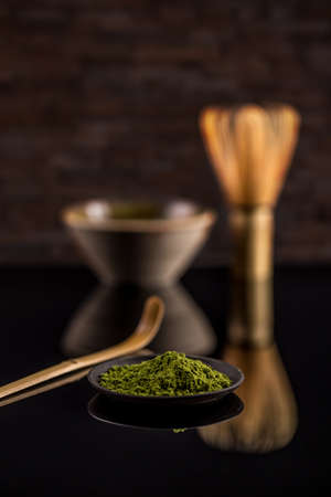 green drink powder: Japanese matcha green tea powder in black plate Stock Photo