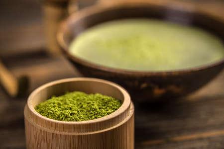 maccha: Organic green matcha tea powder in a bamboo bowl