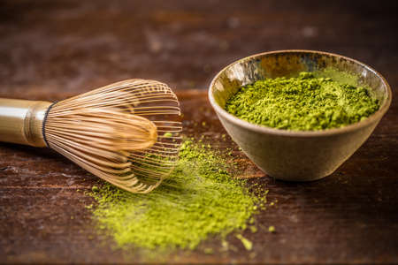 green drink powder: Matcha green tea in bowl with bamboo whisk Stock Photo