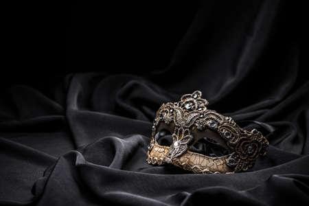 Brown carnival mask on black background Banque d'images