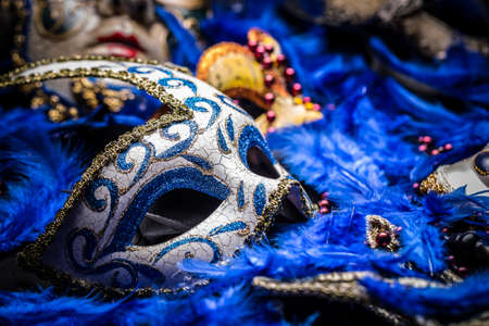 venetian mask: Carnival mask on blue feather background Stock Photo