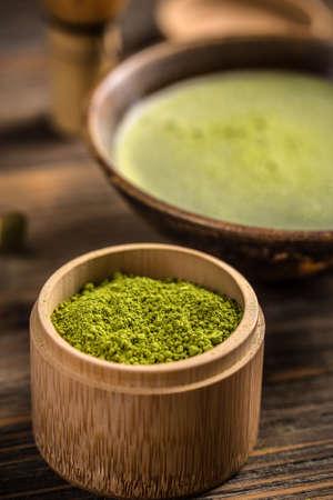 drinking of tea: Matcha, powder green tea in bamboo bowl