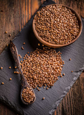 Heap of uncooked brown buckwheat groats