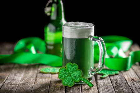 St Patricks Day concept green beer with shamrock Stock Photo