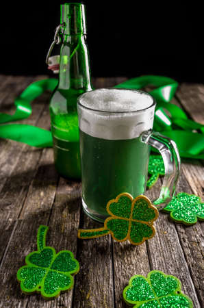 shamrock: St. Patricks Day celebration concept with green beer and shamrocks Stock Photo