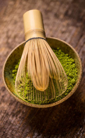 maccha: Raw organic green matcha tea in a bowl with whisk Stock Photo