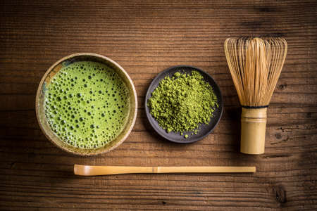 matcha: Japanese tea ceremony setting on old wooden bench Stock Photo