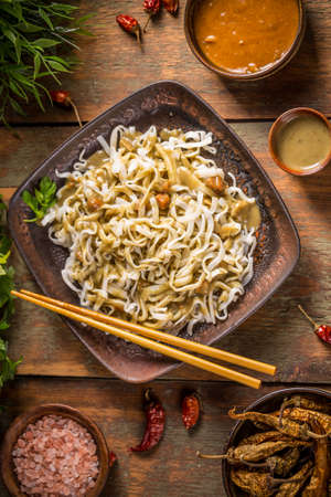 thai noodle: Bowl of noodles with green curry sauce, top view shot