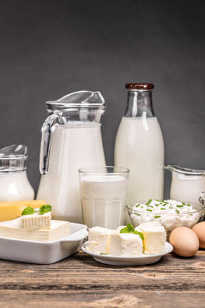 Dairy products on old wooden table