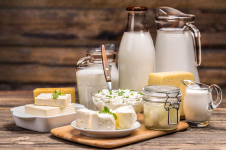 Still life with dairy product on wooden background