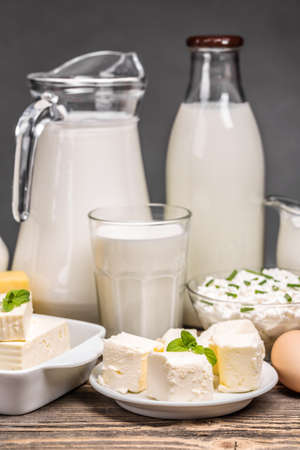 milk products: Fresh dairy products on an old wooden board Stock Photo