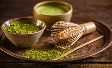 Healthy green matcha tea in bowl