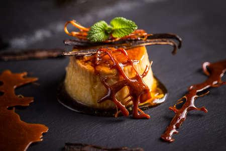 vanilla pudding: Vanilla pudding dessert on black slate