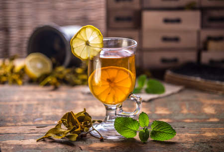 glass cup: Glass cup tea with mint leaf and lemon