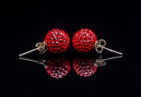 swarovski: Stylish jewelry on a reflection black background Stock Photo
