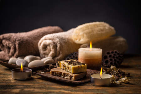 hypoallergenic: Bars of natural soap with vanilla, candle and towel