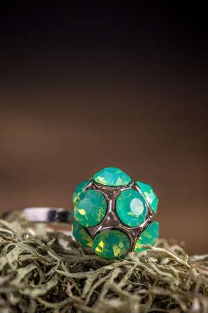 rhinestone: Ring with rhinestone on brown background