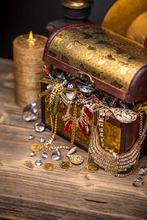 diamond candle: Open treasure chest, full of jewellery Stock Photo