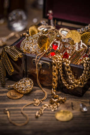 treasure trove: Small pirate treasure chest on wooden table Stock Photo