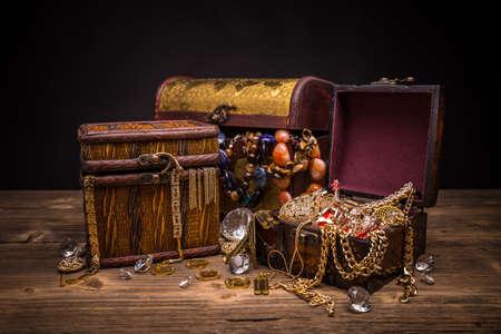 Small pirate treasure chest on wooden table Archivio Fotografico