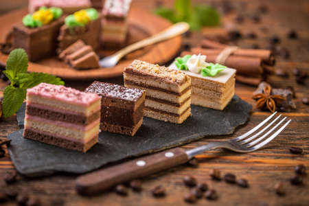 chocolaty: Small square cakes with different cream on black slate