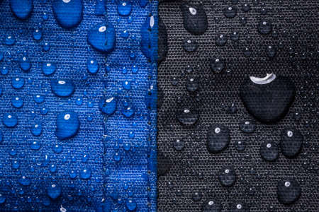 tex: Waterproof textile background with water drops