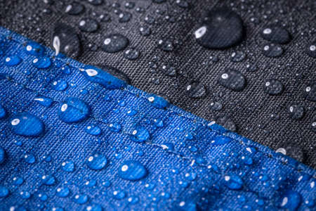 Rain water droplets on fiber waterproof fabric Stock Photo