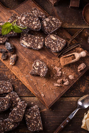 salami slices: Chocolate salami slices on a chopping board Stock Photo