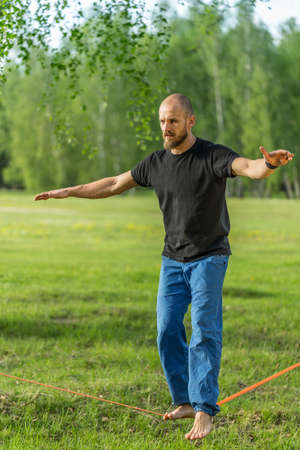 slack: Man practising slack line in the park