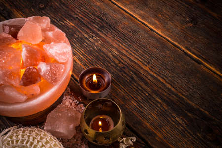 aromatherapy candle: Alternative medicine concept with salt lamp and aromatherapy candle Stock Photo