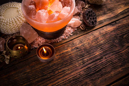 salt lamp: Salt lamp of pink Himalayan salt on vintage wooden background
