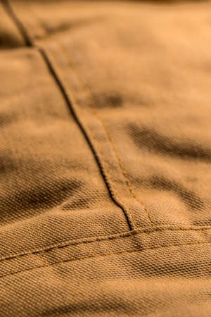 stitches: Detail of brown coat with seam stitches Stock Photo