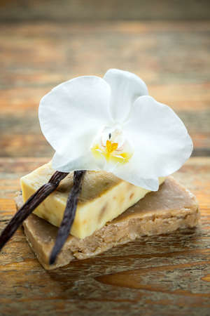 scented soap: Handmade vanilla scented soap on wooden background Stock Photo