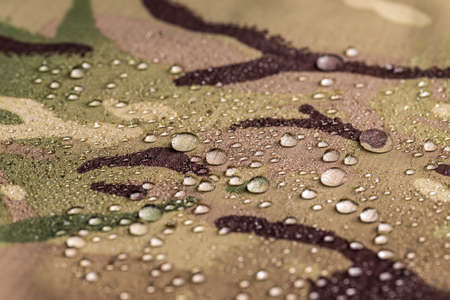 Waterproof textile fabric with rain drops