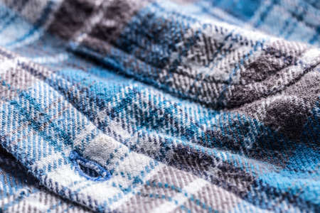 blue plaid: Close up detail of a blue plaid button up style shirt Stock Photo