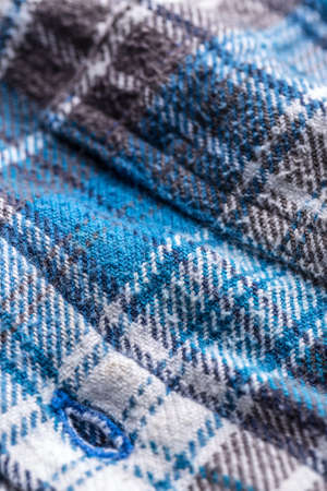checked fabric: Blue checked fabric with buttonhole, close up