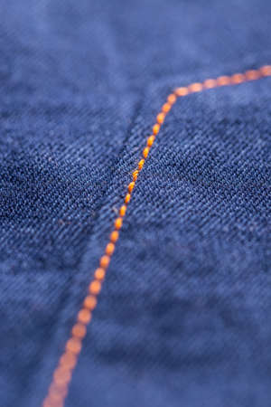 seam: Blue jeans texture with seam