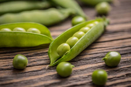 pea pod: Fresh green pea pod on wooden background