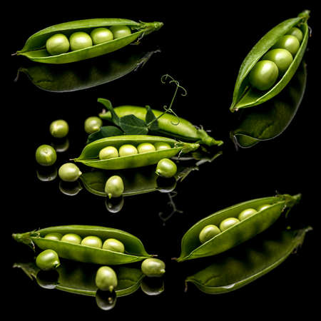 leguminous: Green peas on black clipping path background