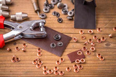 punch press: Hole punch plier tool press set for leather or sewing crafts Stock Photo