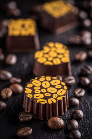 pralines: Coffee pralines on black slate background Stock Photo