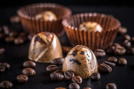 cafe bombon: Chocolate pralines with coffee on black background Foto de archivo