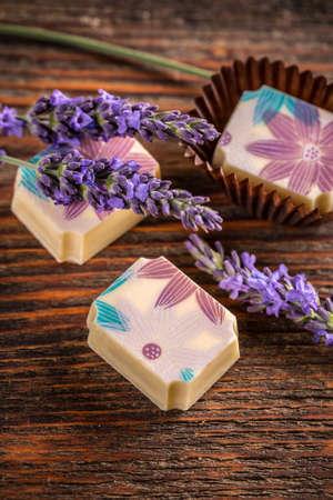 pralines: Lavender pralines on vintage wooden background