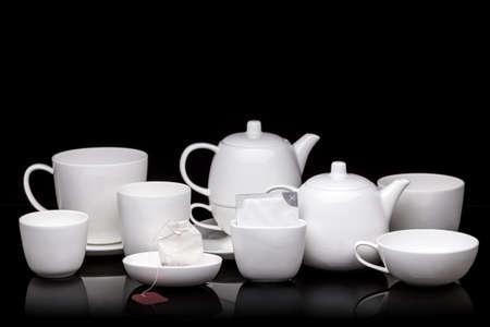 tea service: White tea service on black background