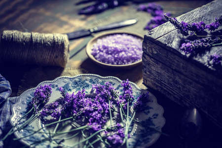 relaxant: Salt herbal body scrub with lavender fresh flowers Stock Photo