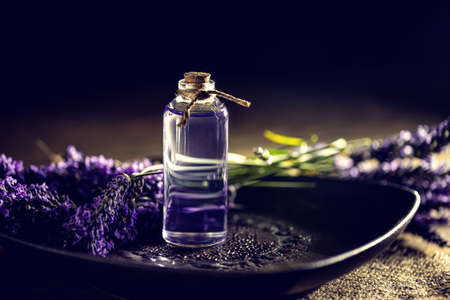 lavender oil: Lavender oil in a glass bottle